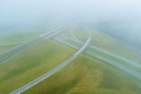 A dense fog in the early morning around the bridge across US 65 Highway near Satsuma, Alabama in USA