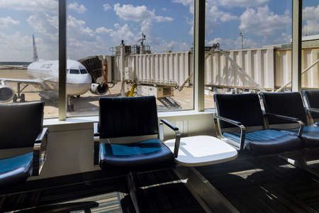 20 SEPTEMBER 2021 Houston, TX USA: View of departure area waiting chairs airplanes from United Airlines the George Bush Intercontinental Airport IAH in Houston, Texas, United States. 新闻类图片