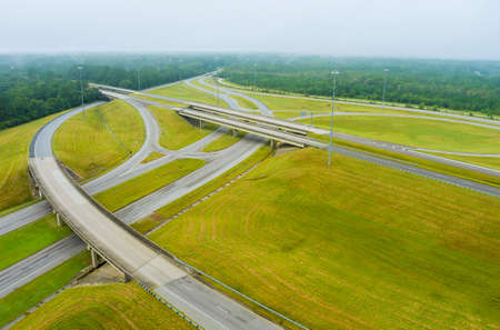 Misty morning over a desolate country road with bridge across US 65 Highway near Satsuma, Alabama in USA