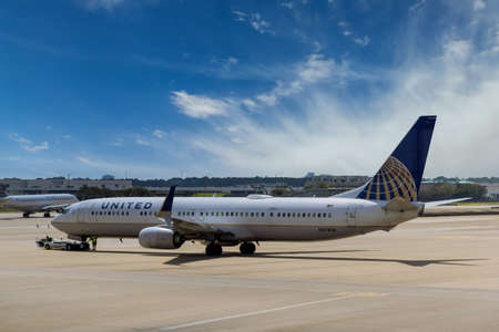 20 SEPTEMBER 2021 Houston, TX USA: United Airlines in airport Houston TX USA with huge vehicle pushing back a airplane