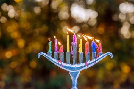Religion of jewish holiday Hanukkah with menorah candelabra candles on soft bokeh