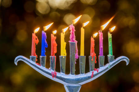 Jewish holiday Hanukkah with menorah traditional burning candles on soft bokeh 免版税图像