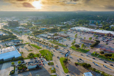 20 SEPTEMBER 2021 Houston, TX USA: Aerial view shopping district parking lot near major road 45 interchanges view overlooking in Houston city Texas USA 新闻类图片