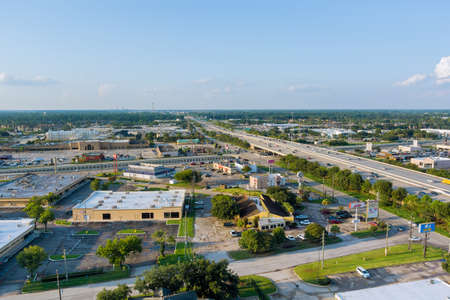 20 SEPTEMBER 2021 Houston, TX USA: Aerial top view of typical a Houston city Texas shopping center with big parking lot near major 45 interchanges freeway