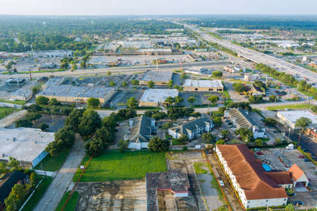20 SEPTEMBER 2021 Houston, TX USA: Aerial overlooking Houston city of beautiful highway Texas with traffic line in 45 Interstate expressway around mall plaza USA 新闻类图片