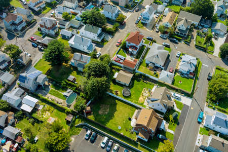 Aerial view of the residential area of beautiful suburb of home dwelling and road from a height in US
