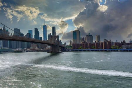 Aerial beautiful sunset cityscape view over Lower Manhattan in New York City United States America on panorama across skyline of Brooklyn bridge