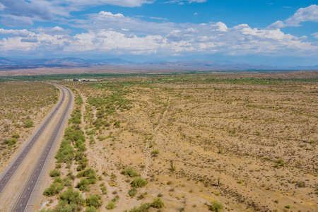 Arizona desert landscape canyon mountain in saguaro cactus near Interstate highway USA 免版税图像