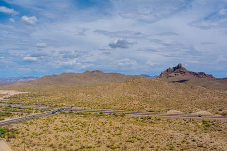 Panorama aerial view rock mountains in the high desert in the middle of the highway of Arizona