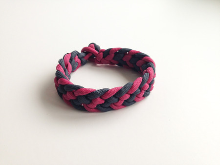 survival: Survival Bracelet made from camouflage Parachute cord Stock Photo
