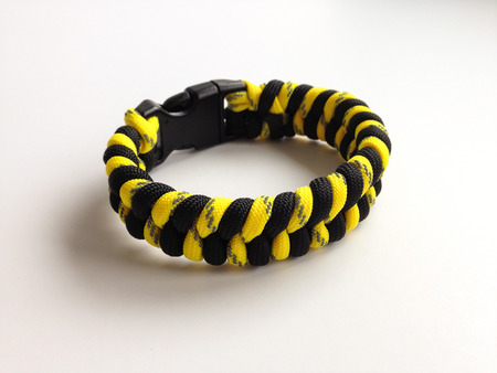 fishtail: Survival Bracelet made from camouflage Parachute cord using the fishtail weave Stock Photo