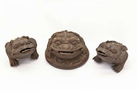 3 Chinese Feng Shui Frog with coins. Isolated on white  photo