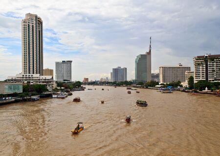 phraya: Boats on Chao Phraya River with High-rise Buliding