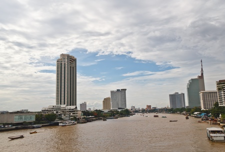 buliding: Boats on Chao Phraya River with High-rise Buliding