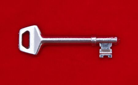 House Key with red background  Stock Photo - 10710504