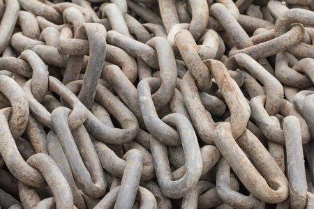 A bunch of large rusty chains photo