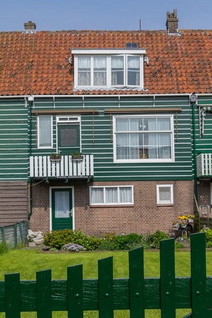 marken: Historic Dutch fishermen village with green wooden houses called Marken