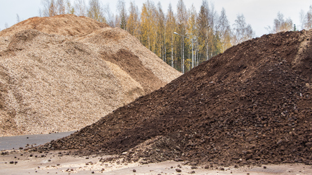 cary: Biomass peat and woodchips ready to be used for heating at a biobased energy plant