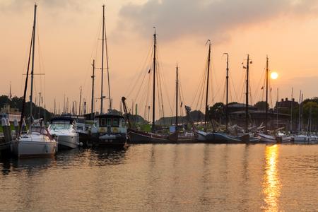 Old Dutch harbor of Enkhuizen at sunset photo