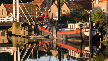enkhuizen: Old historic harbour of Enkhuizen in Holland during sunrise Editorial