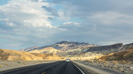 Driving to Zabriskie point during sunset in Death Valley NP US photo