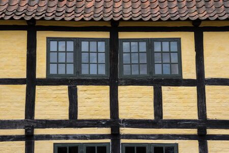 Medieval timbered yellow brown house  in Aarhus, Denmark