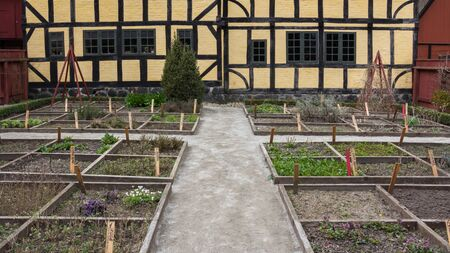 animal den: Old garden and half timered house in Open air museum Den Gamle By in Aarhus Denmark Editorial