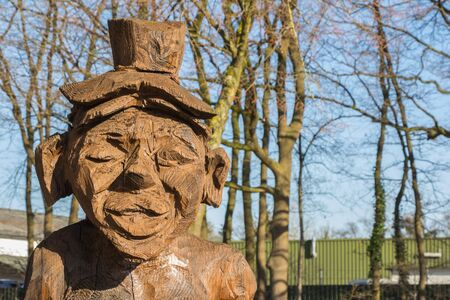 Wooden figure sculpttured with a chain saw photo