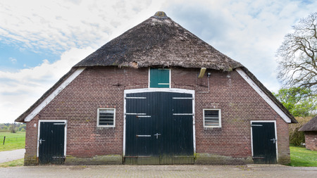 Old  farmhouse in the Netherlands with reed roof photo