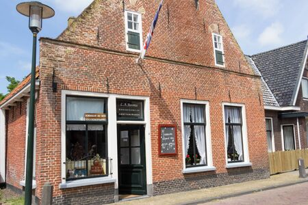 friesland: Ancient Dutch grocery in the small village Exmora in Friesland in the Netherlands
