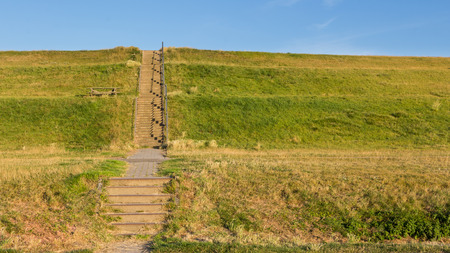 dyke: Stairs to cross a dyke protecting the lower land in the Netherlands
