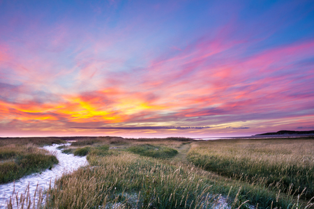 Sunset at the Slufter nature park on the Wadden island of Texel in the Netherlands