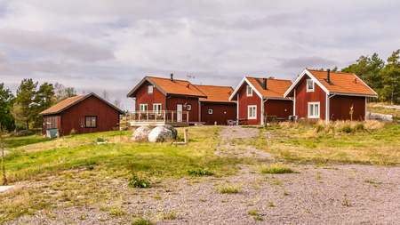 holiday house: Traditional red wooden holiday homes in Sweden Europe Stock Photo
