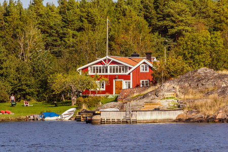 Red cottages on a rock island in in south Sweden