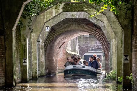 guided: s Hertogenbosch, NETHERLANDS AUGUST 28, 2015: Touriss in a boat on the canals or The Duke Bosch in the Netherlands Editorial