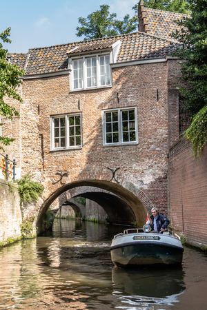 tourist guide: Tourist Guide in a boat on the canals or The Duke Bosch in the Netherlands.