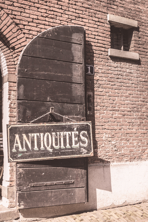antiques: Antiques sign on an old door