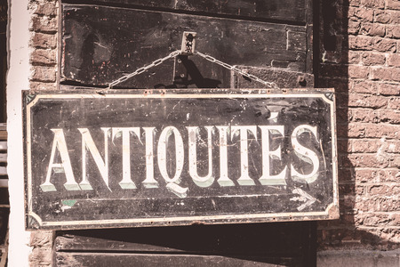 antiques: Antiques sign on an old brick building