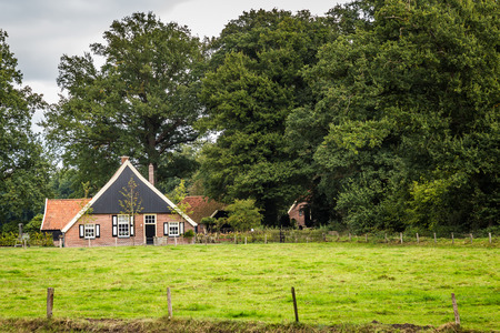Old Dutch farmhouse with black and white shades