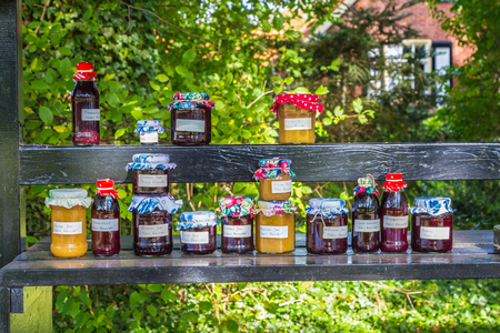 Market stall with home made jam in front of a house Reklamní fotografie - 71289180