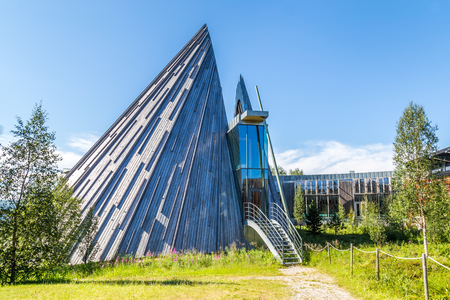 KARASJOK, NORWAY - JULY 24, 2016: The Sami Parliament (Samediggi Sametinget). The parliament is the representative body for Sami people in Norway. The peaked structure of the Plenary Assembly Hall shows the tipis the Sami use as nomades Editorial