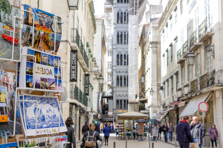 bairro: LISSBON, PORTUGAL - March 5, 2016: Santa Justa elevator with postcards in the front in Lisbon, Portugal