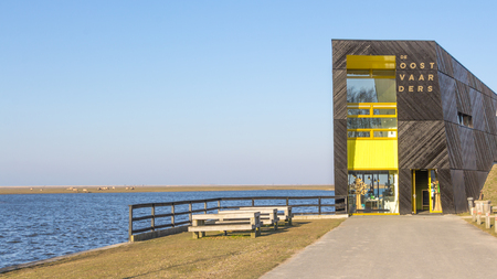 almere: ALMERE, NETHERLANDS - MARCH 17, 2016: Visitor center Oostvaarders in NP Oostvaardersplassen, a large wild reserve with wetland and  large groups of konik horses and red deer.