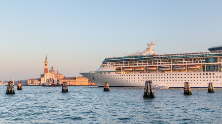 Big cruise ship with tourists leaving the city of Venice Italy  in the evening Stock Photo