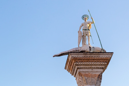 Saint Theodor statue on a column on the Piazza San Marco of Venice in Italy - Colonne di San Teodoro. Stock Photo