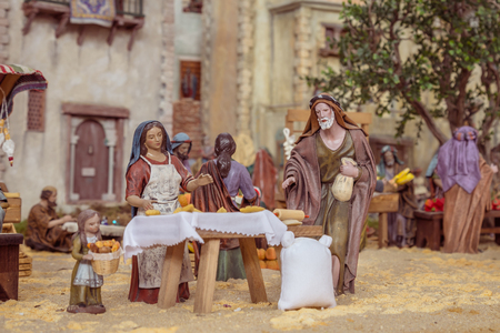 lamb of god: Venice, Spain - December 02, 2016: Nativity scene with hand-colored wooden figures