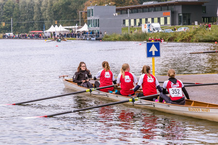 Students preparing for a rowing match on the Bosbaan in Amsterdan Holland. Editorial