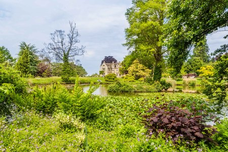 Colorful Britisch castle garden during spring in Suussex, England