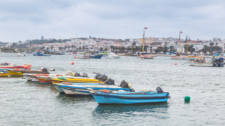 Lagos, Portugal - April, 21, 2017: Dilapidated fishing boats in Lagos Harbor, The Algarve, Portugal