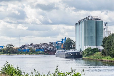 Garbage transhipment along the river in the Netherlands